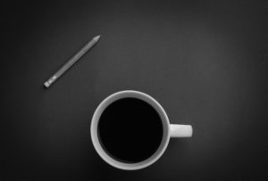 pencil and cup of coffee